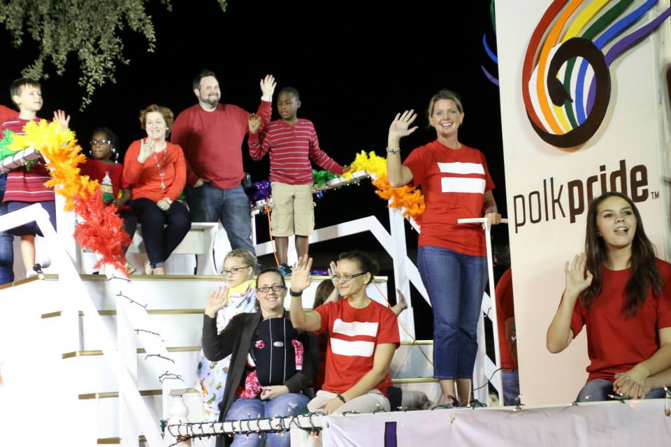 My family (top) rides the Pride float in the Lakeland, FL Christmas parade.